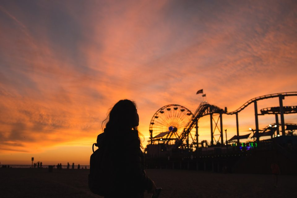 girl at an amusement park, still you hold on