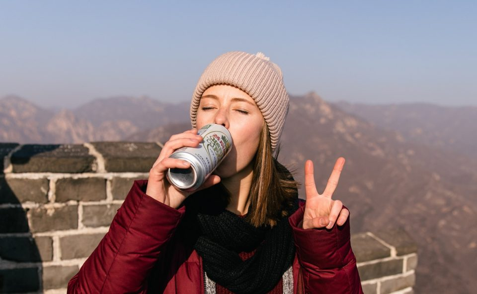 girl with peace sign and drink