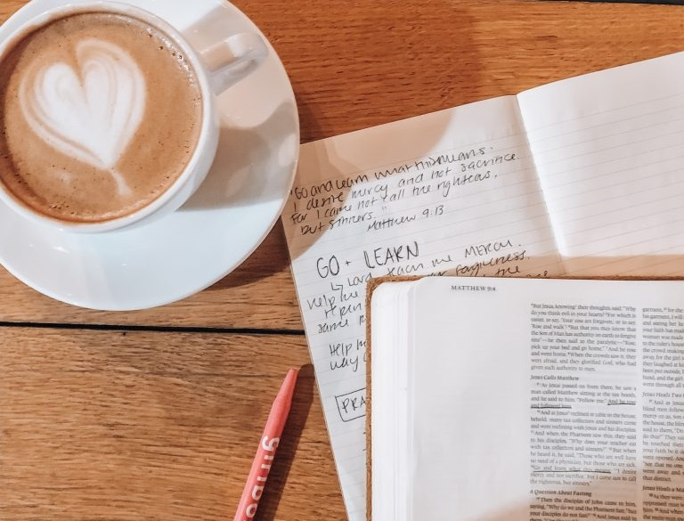 coffee cup and notes on a table