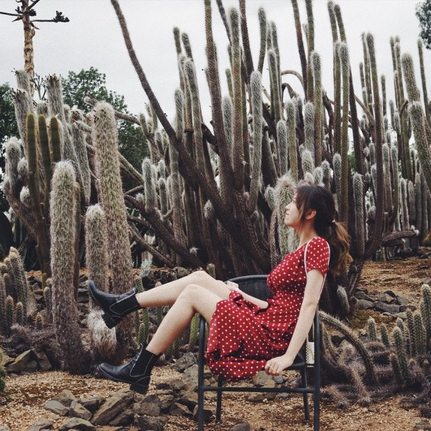 woman with gentle soul around cactus