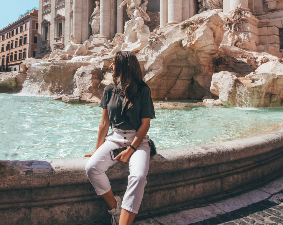 woman sitting by fountain, stop holding yourself back