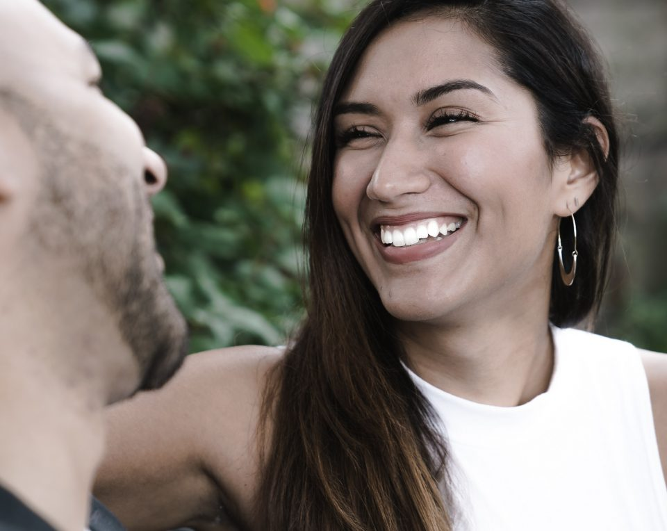 woman with big heart laughing with man